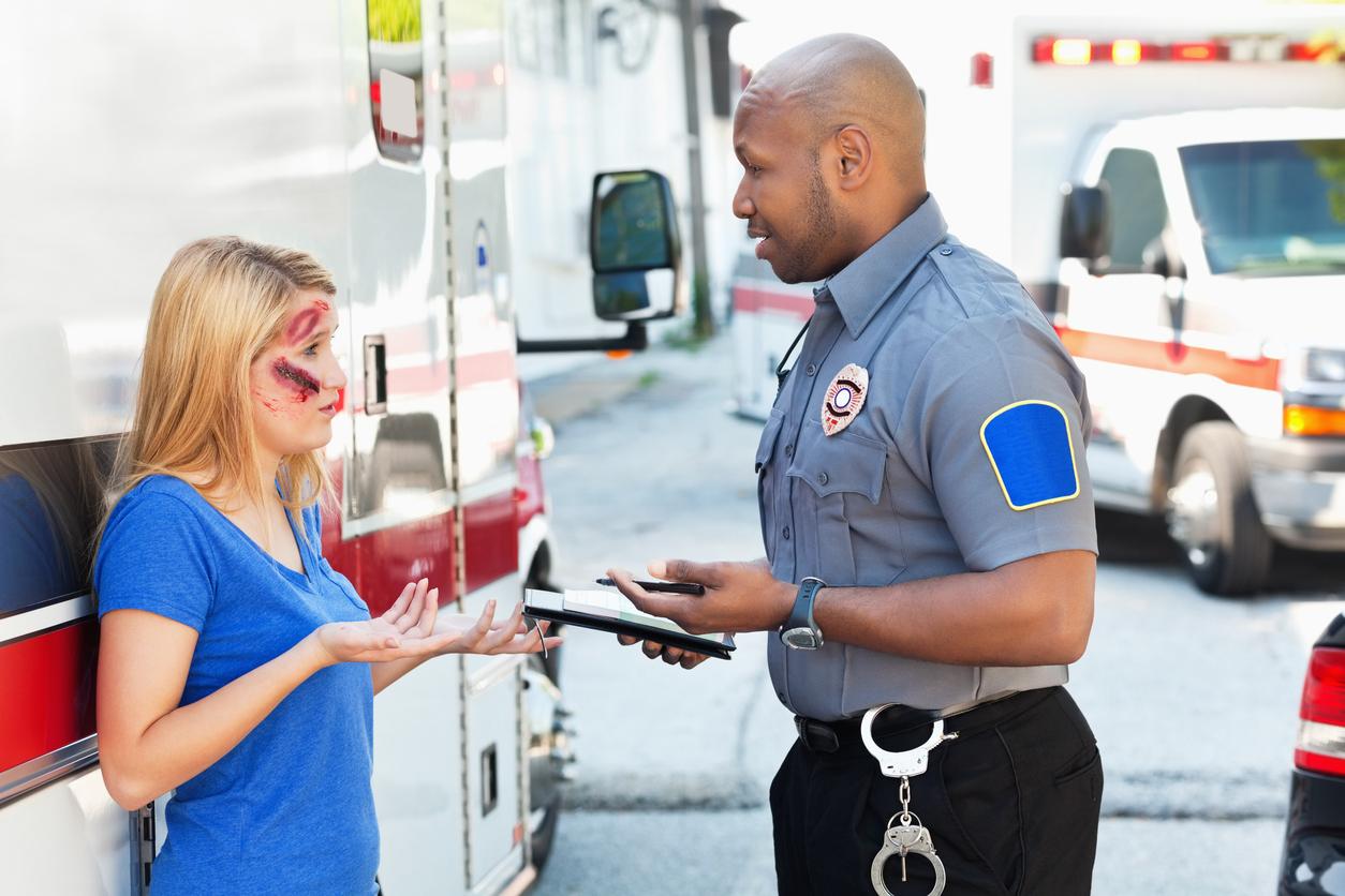 Paramedic speaking to patient