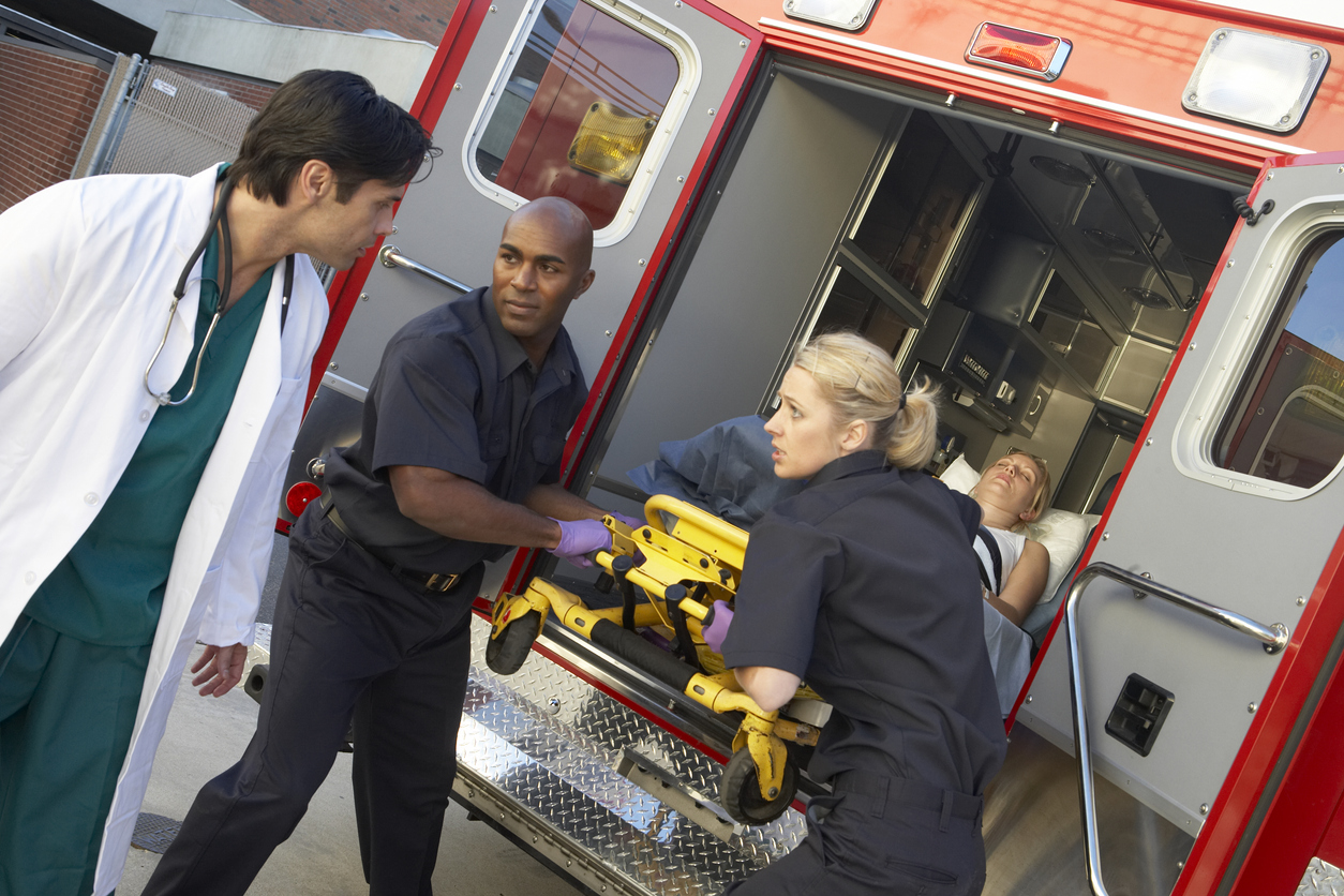Paramedics communicating with doctor
